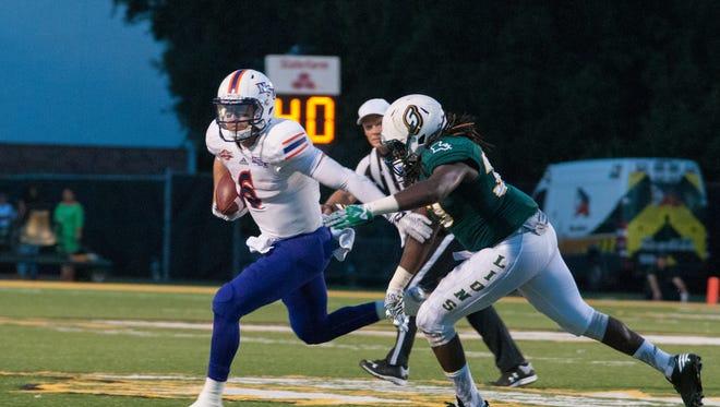 NSU quarterback Joel Blumenthal tries to avoid the Southeastern Louisiana University rush.
