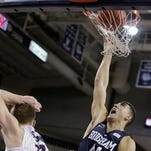 Gonzaga's Domantas Sabonis (11) and BYU's Nate Austin go after a rebound during the first half of an NCAA college basketball game, Thursday, Jan. 14, 2016, in Spokane, Wash.