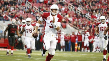 Arizona Cardinals quarterback Carson Palmer takes the ball himself and runs for the winning touchdown against the San Francisco 49ers in the second half on Nov. 29, 2015 in Santa Clara, Calif.