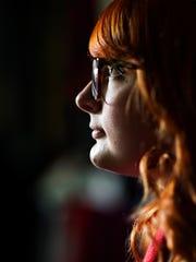 Jessica Calhoun, 26, poses for a portrait at her home