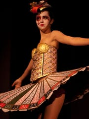 A model wears a dress by a local designer during the 2013 Asheville Community Theatre Costume Drama.