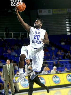 MTSU's Giddy Potts (20) grabs a loose ball and takes it to the hoop during the exhibition game against  Faulkner University at MTSU on Thursday, Nov. 12, 2015.