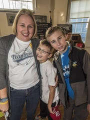 Brenda Ries, left, of Mount Tabor, her son Sean 8, who is battling a tumor, and his brother Brian, 12, at the Good Cookie Bake Off in support of Cookies for Kids' Cancer.