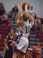Madison Sweitzer (24) tries to shoot a basket over Liz Logan (10) of Shipensburg who is trying to block Sweitzer's shot during a girls basketball game inside Shippensburg's gym on Friday, Dec. 11, 2015 in Shippensburg, Pa.