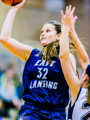 Danni Hanson of East Lansing takes the ball to the basket past a Holt defender Jan. 15, 2016 in Holt.