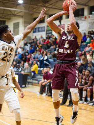 Breaux Bridge senior rises for a jumper in the Tigers loss against Carencro