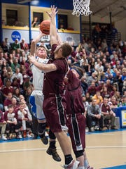 McConnellsburg's Jake Boehme take a shot at the basket as Trent Rider tries to block Boehme's shot during the District 5 boys basketball championship in Johnstown, Pa. on Friday, Feb. 26, 2016. Boehme scored 17 points during the game.