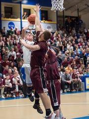 McConnellsburg's Jake Boehme take a shot at the basket