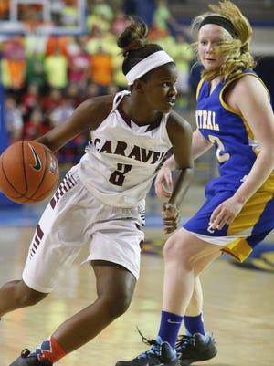 Caravel's Maia Bryson (left) scored 14 points as the Buccaneers defeated Woodbridge on Thursday night.