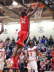 Park Tudor's Jaren Jackson Jr. throws down a dunk in the Panthers win over Beech Grove Friday.