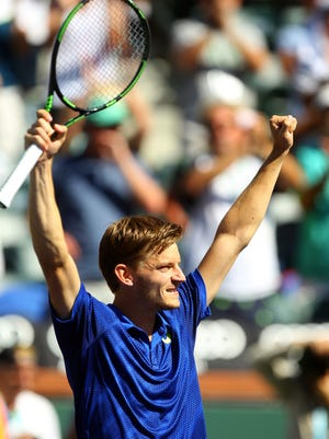 David Goffin of Belgium throws his hands in the air after defeating Marin Cilic of Croatia in straight sets on Thursday, March 17, 2016 during the BNP Paribas Open in Indian Wells, Calif. Goffin won 7-6(4), 6-2.