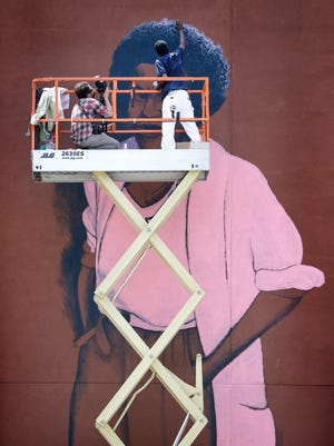 "The mural painting of Indianapolis poet and artist Mari Evans on the side of the Davlan building on Mass Ave. by local artist Michael ""Alkemi"" Jordan continues on July 15, 2016. Big Car's Kurt Nettleton documents the progress alongside Jordan."