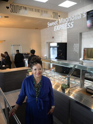 Carolyn Cannon stands in the express area of the newly opened Sweet Magnolia's named after Cannon's mother Magnolia Cannon.
