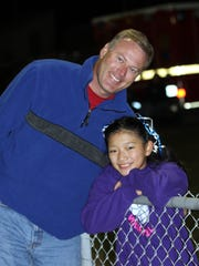 KCCI meteorologist John McLaughlin stops for a picture with Becca Foster, 12, of Des Moines.