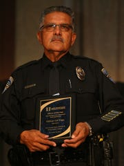 Officer Gil Vega is named Palm Springs Police Department Patrol Operations Officer of the Year on Tuesday, November 26, 2013 during the 17th Annual Peace Officer & Public Safety Awards Luncheon in Indian Wells, Calif. Crystal Chatham/The Desert Sun