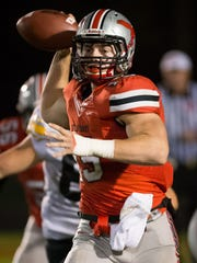 City High quarterback Nate Wieland (15) throws a complete