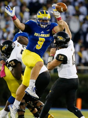 Delaware linebacker Troy Reeder deflects a pass by Towson quarterback Heath Dahlgren in the fourth quarter of Delaware's 20-6 win at Delaware Stadium in Oct. 2016.