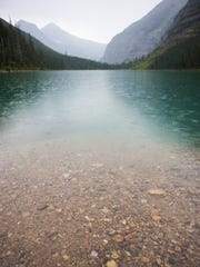 Reddish stones contrast with teal water at Avalanche