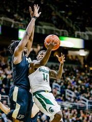 Eron Harris ,14, of MSU takes the ball to the basket while being defended by Caleb Swanigan of Purdue during their game Tuesday January 24, 2017 in East Lansing.  KEVIN W. FOWLER PHOTO