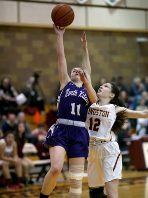 North Kitsap's Lauren Weins (left) drives to the basket past Kingston's Lily Beaulieu on Friday night.