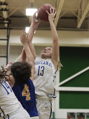 Jenna Martin of Highlands pulls down a crucial offensive rebound.  The Highlands Lady Bluebirds defeated the mighty Thoroughbreds of New Cath in the District finals held at Dayton High School Thursday, February 23, 2017.