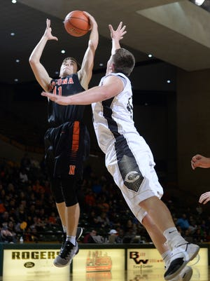 Canadian's Tyler Richardson (44) goes after a rebound against Nocona's Riley McCasland (11) in the 3A boys basketball semi-final game Friday, March 3, 2017, at Chaparral Center.