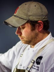 Executive Chef Sean Wilson prepares dinners during