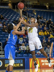 Delaware's Nicole Enabosi, a first-team All-CAA pick, puts up a shot over Hofstra's Ashunae Durant.