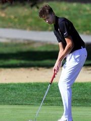 Central York's Brady St. Pierre putts during the PIAA