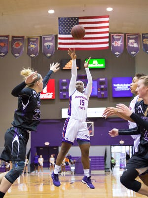 Northwestern State's Jasmyn Johnson (15) goes for a shot against Stephen F. Austin defenders as the Lady Demons take on the Ladyjacks Saturday Jan. 6, 2018.