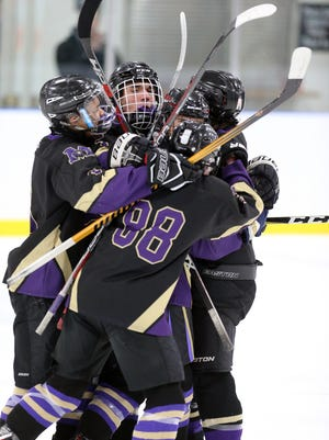 Monroe celebrates its first goal against Colonia during the GMC Cup final on Friday, Feb. 16, 2018.
