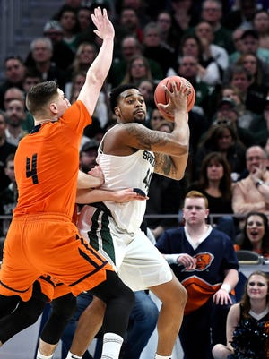Michigan State's Nick Ward looks to pass during the first half on Friday, March 16, 2018, at the Little Caesars Arena in Detroit.