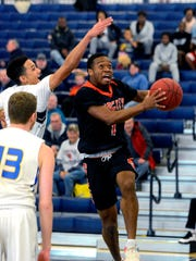 Northeastern grad Fred Mulbah, shown here in a file photo from last season, was named the Pennsylvania State Athletic Conference's Men's Basketball West Division Freshman of the Week after scoring 18.5 points per game for the Mountain Cats last week. DISPATCH FILE PHOTO