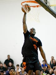 Team Splatter's Joshua Langford dunks the ball on Thursday,