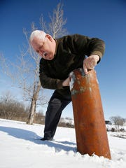 Weather observer David Sayre demonstrates how he takes