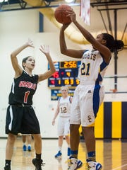 Sussex Central guard Jasmine Hudson (21) takes a shot against Ursuline Academy's Alisha Lewis (1) in Georgetown on Wednesday evening.