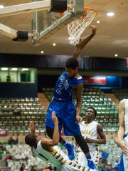 Stephen Decatur Keyon Eley (2) goes for a dunk against