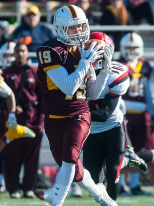 Salisbury wide receiver Josh McClain (19) hauls in a pass against Albright College in the Eastern College Athletic Conference?South Atlantic Bowl Game on Saturday afternoon at Sea Gull Stadium.