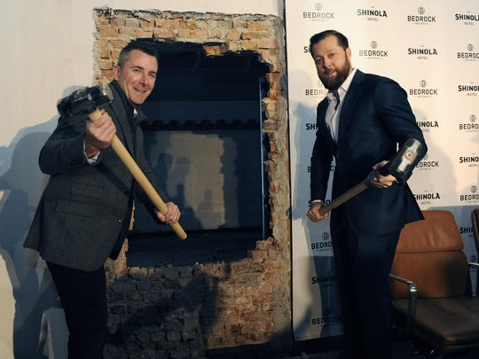 Shinola's CEO Tom Lewand, left, and Dan Mullen, Executive VP, Bedrock, pose with hammers after the ceremonial busting of the wall at the Shinola Hotel groundbreaking on January 31, 2017.