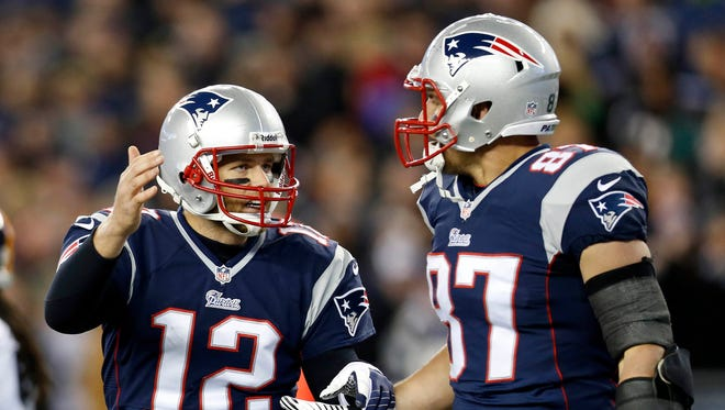 New England Patriots quarterback Tom Brady (12) congratulates tight end Rob Gronkowski (87) for a second-quarter touchdown reception against the Pittsburgh Steelers at Gillette Stadium in Foxborough, Mass. on Nov. 3, 2013.