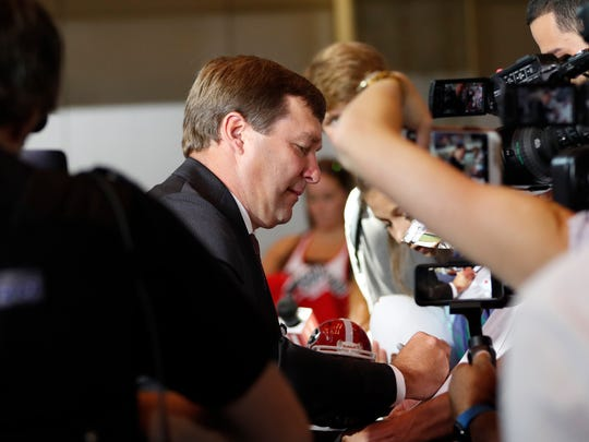 Georgia head coach Kirby Smart signs autographs as he arrives for Southeastern Conference Media Days Tuesday, July 17, 2018, in Atlanta. (AP Photo/John Bazemore)