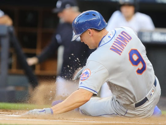 Brandon Nimmo scores the first run for the Mets in