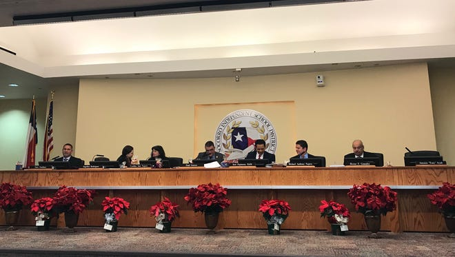 Trustees for the Socorro Independent School District return from a closed session at a meeting Dec. 12.