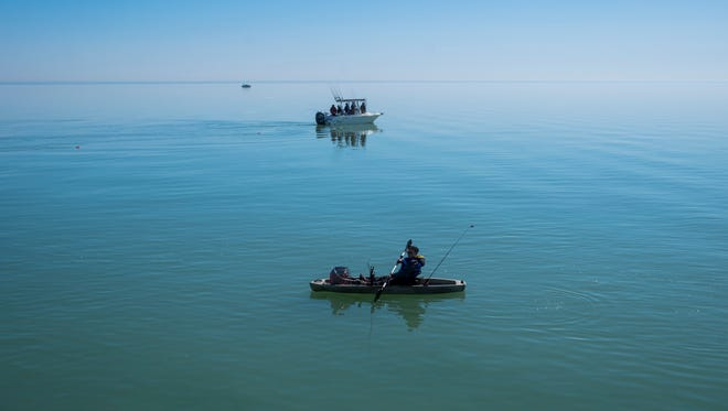 Fishermen enjoy a Spring morning on Lake Huron Sunday, April 22, in Lexington, Mich.