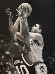 Daryl Thomas shoots over Michigan State's Barry Fordham