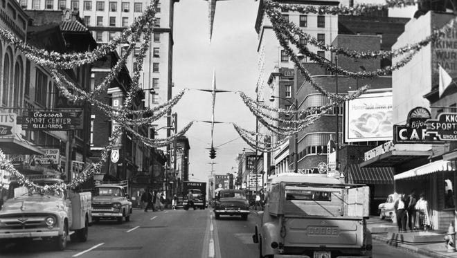 Gay Street is decorated for Christmas on Nov. 13, 1962. The original caption: The 'Starlight Stairway,' the new Gay St. Christmas decoration, is well underway. Note the huge silver stars, 21 in all, which will center Gay St., five to the block. Between the stars and sidewalks will be festoons of gold and silver intermingled with thousands of vari-colored lights.