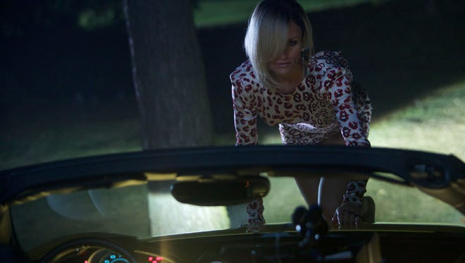 Cameron Diaz slinks on to the hood of a Ferrari in 'The Counselor'