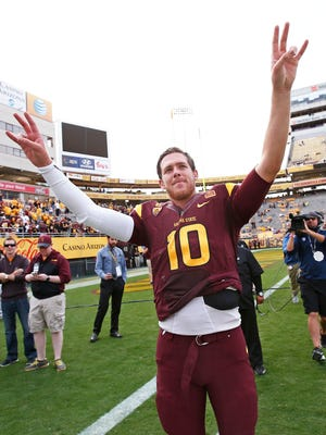 Arizona State quarterback Taylor Kelly acknowledges the crowd after playing his final game at Sun Devil Stadium on Nov. 22.