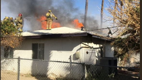 Firefighters battle a house fire on Miles Avenue in Indio. No injuries were reported.