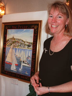 Artist Elizabeth Mumford shows a painting that was auctioned off at the 1998 Figawi Ball. The painting graced the cover of the Figawi program. Mumford frequently donated artwork to be auctioned for community causes.